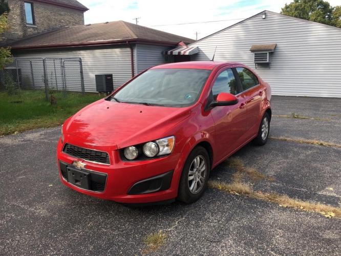 2012 RED CHEVROLET SONIC LT (1G1JC5SH3C4) with an 1.8L engine, Automatic transmission, located at 1708 Broadway, Rockford, IL, 61104, (815) 397-5010, 42.252522, -89.069359 - Photo #0
